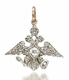 A DIAMOND PENDANT, BY FABERGÉ   Designed as a diamond-set Imperial double-headed eagle, mounted in silver and gold, 1880-1890, 2.6 cm, in pink velvet fitted Wartski case  By Fabergé, with workmaster's mark AT for Alfred Thielemann