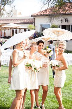 Bridesmaids keeping out the California sun: http://www.stylemepretty.com/california-weddings/rancho-santa-fe/2014/04/09/modern-garden-party-in-southern-california/   Photography: Studio 28 - http://studio28photo.com/