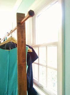wood and copper clothing rack