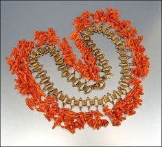 "Miriam Haskell Coral Bib Necklace Bookchain /  Spectacular 1930s Art Deco Miriam Haskell necklace! Genuine branch coral is suspended from a gold tone bookchain and ends with a thumb ring clasp. Haskell produced beautiful coral jewelry during the 1930s with branch coral and called the line ""spezzati"". This necklace has been verified as Haskell / 275"