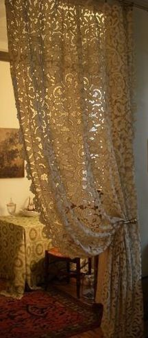 Heavy lace curtains! I must find these! --don't judge me. I think they are fabulous!