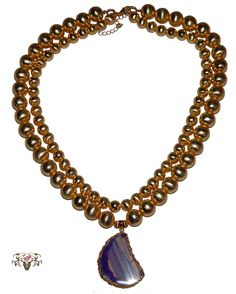 Here is our Copper two tier Necklace with an all natural Amethyst dipped in gold pendant. You won't find all natural stones anywhere cheaper than www.twistedthingamajigs.com as we sell unique handmade jewelry at wholesale prices.