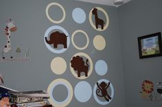 Boys nursery decor idea with concentric dots and jungle animal silhouettes