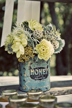 Flowers in a recycled can. Love the colour palette.