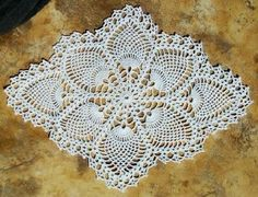 This is a pretty easy pattern to follow and quick to make. This Doily measures 10 x 14 inches if you follow the instructions and materials indicated in the pattern. With a really beautiful shape, this Pineapple Doily by The Spool Cotton Company is a wonderful doily for any occasion. ————————————– MATERIALS: J. & P. …