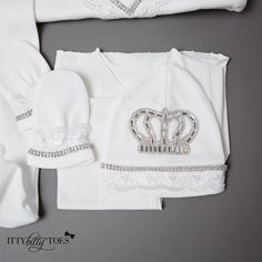 10-piece soft, thick cotton set is embellished with lace, rhinestones, and jeweled crowns. Each decorative detailis individually glued onto the onesie. Set inc