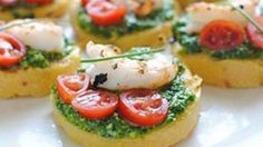 Polenta rounds with spinach pesto, shrimp, tomatoes, & chives