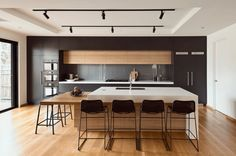 Modern design trends generally point to all white as the kitchen color palette of choice. But what about on the opposite end of the spectrum?