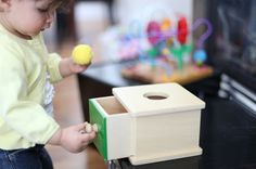 "Traditional Montessori Materials in the Infant/Toddler Environment: Imbucare boxes are a Montessori infant/toddler material which is named from the Italian verb for ""to mail."" Like object permanence boxes, an Imbucare box helps children understand how one object can be hidden inside another while working on motor skills."