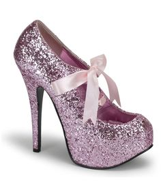 """Teeze pump in baby pink glitter has a 1 3/4"""" concealed platform. With a 5 3/4"""" heel and a baby pink ribbon tie at the top of shoe. Bordello Shoes offers a large selection of sleek to shiny patents, sa"""
