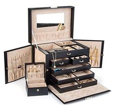 5 slide out drawers; 20 compartments;10 necklace hooks;3 large storage pouches;Lined in silsuede and finished in oiled leather and durable synthahide; * 2 removable earring holders which hold up to 30 earrings (10 hanging, 20 posts) * Twin fold out side compartments with snap closures. Great for hanging necklaces, bracelets, and other; * Lock with a key ;Large mirror on top lid;removable mini travel jewelry box (shown at rear left of the jewelry box) that holds even more rings/necklaces/earr