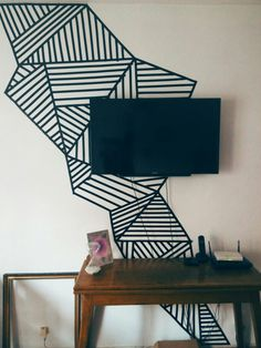 Masking tape wall mural to disguise those ugly tv wires