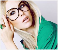 big black frames with blue eyes, green ring and blouse