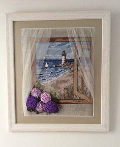 Camdan deniz feneri manzarası.