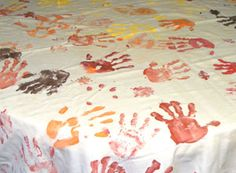 """You will enjoy using this """"hand-made"""" Thanksgiving tablecloth as much as the kids will enjoy creating it. It's great way for the whole family to create a treasured memory."""