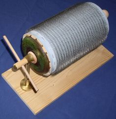 DIY instructions to build your own minimalist carding drum! Not a full carder, but halfway between hand cards and a drum carder. // Spinning Forth - Minimalist Carder