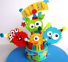 Monsters Birthday cake topper or party centerpiece.  The figures are made of hardening durable clay and they will be painted to match your colors.