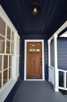 Our First Flip craftsman wood front door front porch fixer upper house flip before and after re Front Porch Remodel, House Front Porch, Front Porches, Garage Door Styles, Garage Door Design, Garage Doors, Craftsman Front Doors, Wood Front Doors, Building A Porch