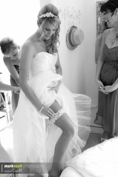 Adjusting the garter Wedding Photography, Mark Noall Photography, Bride Cornwall