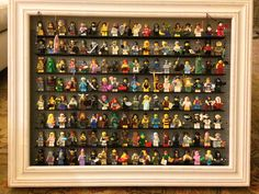 My own LEGO shadowbox of 144 Collectible Minifigures. Series 3,4,5,6,7,9,10,11,12. Restoration hardware shadowbox and 2 large grey LEGO baseplates cut with exacto knife.