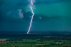 Cloud Ground Lightning - Catch of the day, with close up lightning entering ground from clouds and heavy rain around coming toward us standing on Quarin mountain, above Cormons (Friuli Venezia Giulia region - Italy). The best place to watch storms.