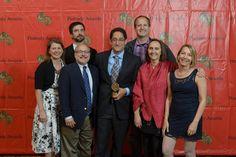 "Kerri Hoffman, Ben Adair, John Barth, Aaron Glantz, Susanne Reber, Jake Shapiro and Amy Pyle with the 2013 Peabody Award for ""Reveal: the VA's Opiate Overload."""