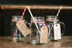 hand etched initial mason jars + stripy straws + bakers twine + cute stamped luggage tags = adorable favors!