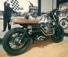 sweet bike in a sweet garage ( # @moto_strada_bikes ) #caferacer #caferacerxxx…