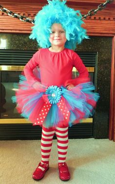 This is a listing inspired by Dr. Seuss Thing 1. This listing is for a vibrant red and turquoise tutu finished off with a bow and matching