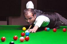 KARACHI: A pose of Abu Saim during the Jublee Insurance Snooker Championship, here on Saturday. -Photo by Sohail Rafiq