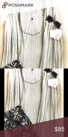 Long flowy layering fashion vest New Lula Roe light grey ribbed Joy!  This is an essential piece that literally matches everything!!! Add style with this light following layer.  Hide mid section area and elongate your body!  A must have fashion piece.  Beautiful long side slits help this vest to flow as you go.  Get it before it's gone! LuLaRoe Accessories Scarves & Wraps