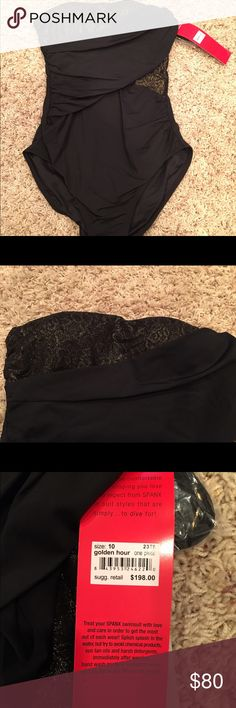 SPANX Swimsuit one piece Golden Hour Lace Jaw dropping SPANX swimsuit. Black with gold metallic lace accents. Extremely flattering. Includes neck strap. Retails for $198. Size 10 SPANX Swim One Pieces