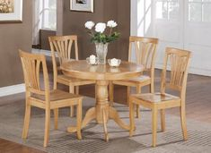 East West Furniture ANAV5-OAK-W 5-Piece Round Kitchen Table Set, Oak Finish  Glossy Antique small table set brings sophistication to any dining area or breakfast spot. Finished in a comfy Oak color to enhance any decor. This 36 inch circular table top with beveled sides is fine looking enough to present fine china and strong enough for a friends and family barbecue. Supported by a fashionable 30 inch pedestal that comes with stylishly created legs. Wonderful, high backed dining chair..