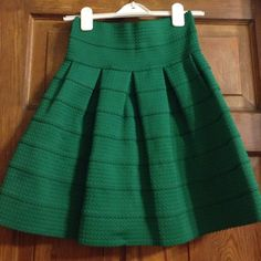 Anthropologie Green Bell Skirt Girls from Savoy This emerald green Girls from Savoy bell skirt was purchased from Anthro two years ago and worn once. Pair it with a cream polka dot button down or a chambray top for a fresh spring look. Beautiful pale blue zipper detail on the back. Order today to get it in time for St. Patrick's Day or Easter!! This item is in excellent condition. Anthropologie Skirts