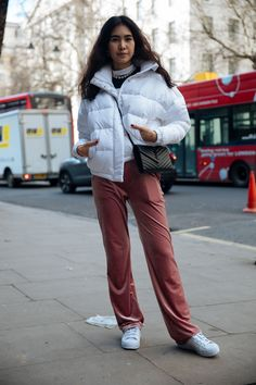 A lesson in athluxury: Dress up a puffer and sneakers with pearls and an elegant bag.