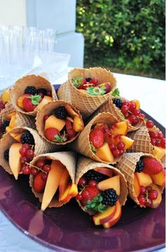 Great idea to serve fruit at any party! Coat the interior of the cone in chocolate of your choice to prevent it from going soggy. Plus who can say no to chocolate!!! Someone even suggested rolling the ends in nuts or sprinkles…