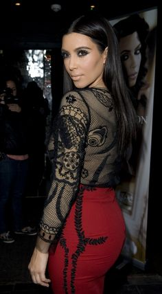 29d074de3fd4 Kim Kardashian Photos - Kim Kardashian wears a lace top and skirt at a  photocall at the Rose Club to promote her new fragrance