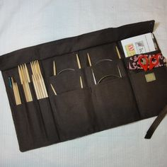 "Travel Knitting Needle Case - Custom Made  - Holds needles and patterns your choice of fabrics. $48.00, via Etsy. (""lets knit"" is my fabric choice)"