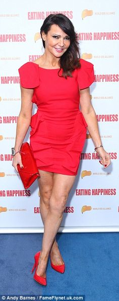 Red hot! Lizzie Cundy  put on a glamorous display as she flaunted her lean legs in the mini dress