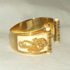 """Iconic & Rare Art Deco c.1934 Seahorse Bakelite & Brass Bracelet by JEAN PAINLEVE- Paris.  Wow, see this iconic entwined Seahore bracelet by Jean Painleve for sale at the """"Vintage Jewelry Stars"""" shop at http://www.rubylane.com/shop/vintagejewelrystars!!"""