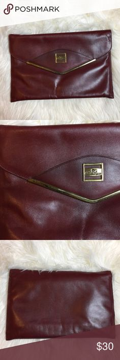 Vintage Etienne Aigner leather clutch purse 👛 Vintage Etienne Aigner maroon leather clutch. Envelop style. So classic and chic. In great vintage condition. 13x9 one zip pocket inside Etienne Aigner Bags Clutches & Wristlets