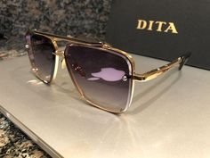 New (never used), Retail $1,000 plus tax Make me an offer Brand new in original packaging DITA MACH-SIX Frame - yellow gold, marble Lens - grey gradient TITANIUM LENS RIM. SCREW MOUNTED LENSES FORKED
