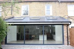 Client: Rebecca Brief: To create a large rear kitchen extension with three panel high quality sliding doors. The client wanted the affect of the internal floor running at the same level as the external patio, giving the affect of a continuous floor from inside to out. Timescale: 12 weeks This beautiful extensionin Middlesex is a …