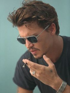 Johny DePP, I found this on geek and who ever pined it put, johnny Deep. But mr. DePP why not stop smoking, Mr. Beautiful.