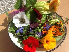 Salad from the garden with a few unusual ingredients - a bit pretentious but here we go: lettuce, spinach, red amaranth, edible chrysanthemum, giant goosefoot, courgette, courgette flower, borage flower, nasturium flower, white Vulcan flower, peas, bladder campion and marigold petals! Tasted good too especially the giant goosefoot.