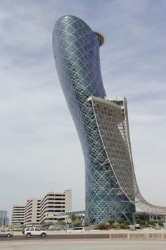 Capital Gate - This skyscraper from Abu Dhabi was designed with this lean in mind (unlike the tower of pisa). It is 160 meters and 35 stories tall. It is the worlds furthest leaning man made tower and has a lean westward. List Of Tallest Buildings, Famous Buildings, Amazing Buildings, Modern Buildings, Interesting Buildings, Architecture Paramétrique, Futuristic Architecture, Contemporary Architecture, Amazing Architecture