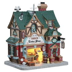Lemax Theo's Tinker Shop. SKU# 75247. Released in 2017 as a Caddington Porcelain Lighted Building.