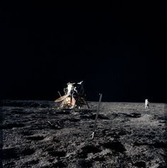 Lonely At The Top After deploying the S-band antenna and the solar-wind experiment and after erecting the flag, the Apollo 12 crew moved around the Lunar Module LM and photographed their spacecraft on the edge of the Surveyor Crater.