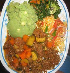 Kenyan cuisine .Stew,potatos,cabbAge and Mokimo