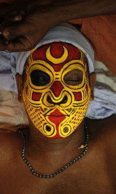 Rest time during makeup for Theyyam worship, North Malabar in Kerala, India, by National Geographic